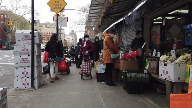 people shop in one of the few remaining markets still open in manhattan's chinatown as the coronavirus keeps businesses mostly closed on april 23,... - chinatown stock videos & royalty-free footage