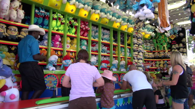 ms people shopping and playing at stampede park / calgary, alberta, canada - fairground stall stock videos & royalty-free footage