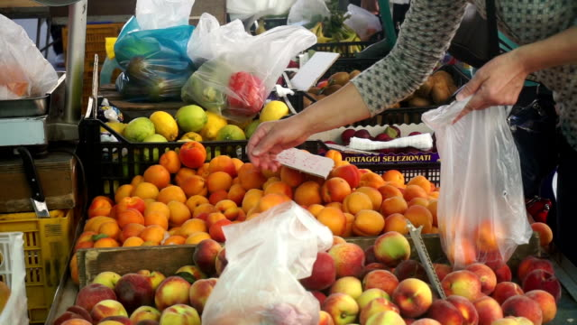 people shopping at at street market in italy - market stall stock videos and b-roll footage