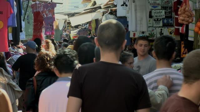 ms pan people shopping at carmel market / tel aviv, israel - tel aviv stock videos & royalty-free footage