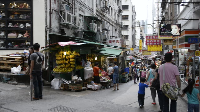 ms people shopping at fruit shop / hong kong, china - pavement stock videos & royalty-free footage