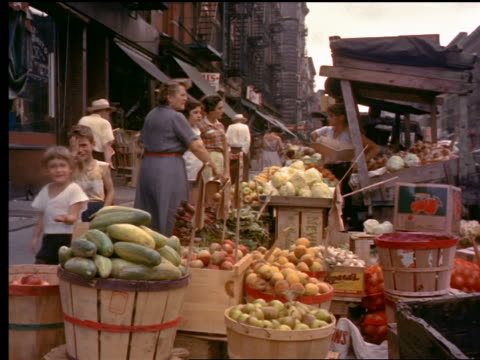 1953 people shopping at fruit/vegetable stand on side of street / new york city - greengrocer stock videos & royalty-free footage