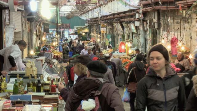 ws people shopping at mahane yehuda market / jerusalem, israel - market stall stock videos and b-roll footage