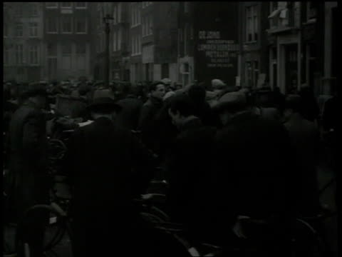 1938 montage people shopping at marketplace / amsterdam, netherlands - judaism stock videos & royalty-free footage