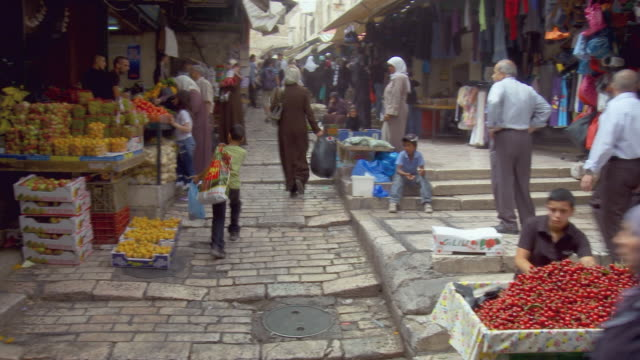 ws pan people shopping at muslim quarter in old city of jerusalem / jerusalem, israel - jerusalem stock videos & royalty-free footage