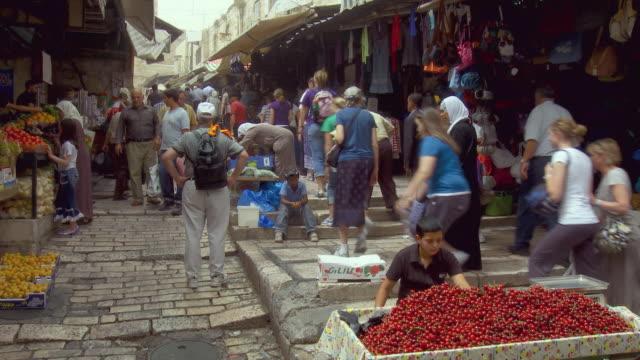 ws pan people shopping at muslim quarter in old city of jerusalem / jerusalem, israel - jerusalem old city stock videos and b-roll footage