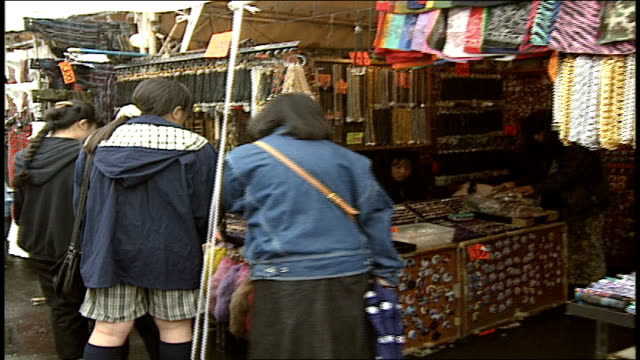 people shopping at punk street vendor stands in harajuku japan - 1990 stock videos & royalty-free footage