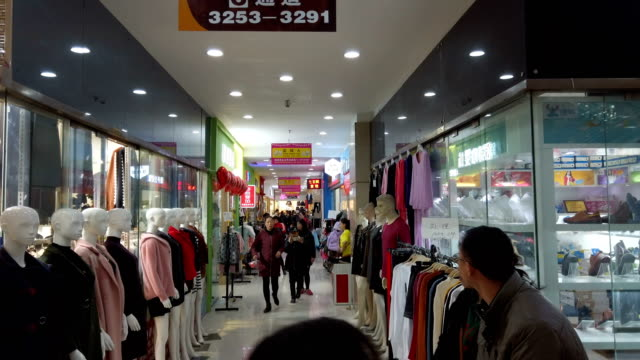 vídeos de stock, filmes e b-roll de people shopping for clothes in shopping mall,xi'an,shaanxi,china. - shopaholic