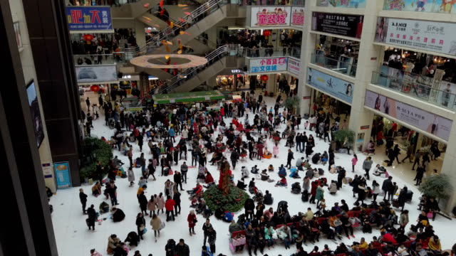 people shopping for clothes in shopping mall,xi'an,shaanxi,china. - メガストア点の映像素材/bロール