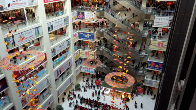 people shopping for clothes in shopping mall,xi'an,shaanxi,china. - shopping centre stock videos & royalty-free footage