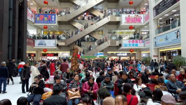 people shopping for clothes in shopping mall,xi'an,shaanxi,china. - mittlerer teil stock-videos und b-roll-filmmaterial