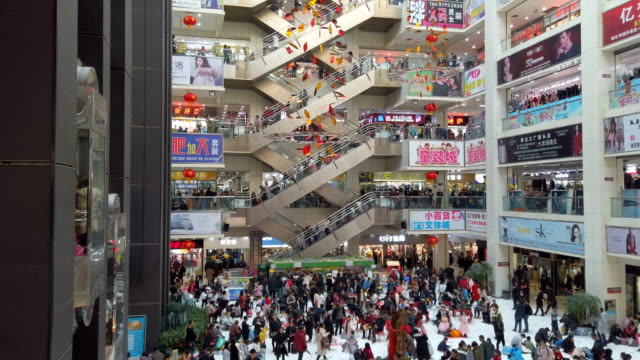 People shopping for clothes in shopping mall,Xi'an,Shaanxi,China.
