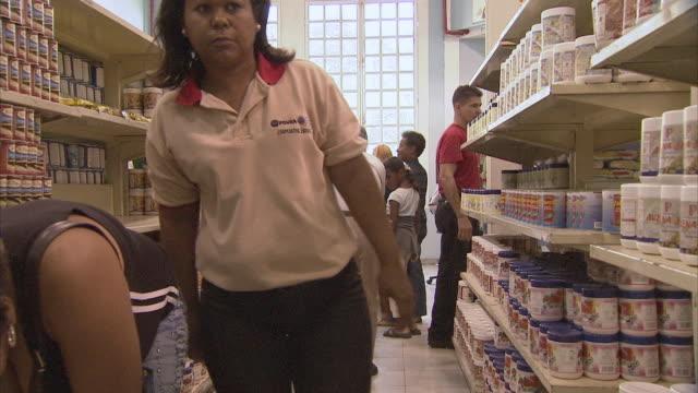 MS PAN TU TD People shopping for food at Mission Mercal store / Cabimas, Zulia, Venezuela