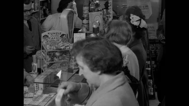 people shopping for food inside a busy, crowded shop in uk; 1956 - 1956 stock videos & royalty-free footage