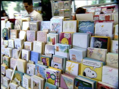 vídeos de stock, filmes e b-roll de people shopping for greeting cards in miami florida - símbolo conceitual