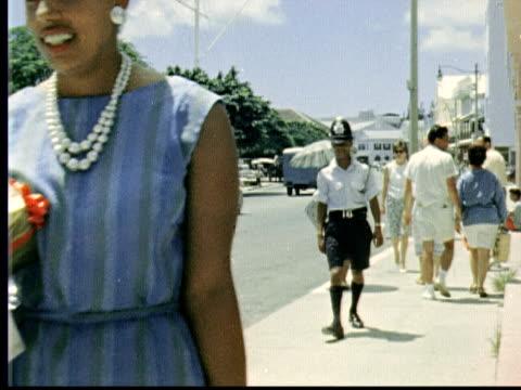 1963 montage people shopping / hamilton, bermuda - bermuda stock videos & royalty-free footage