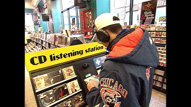 people shopping in a tower record's store in new york. - compact disc stock videos & royalty-free footage