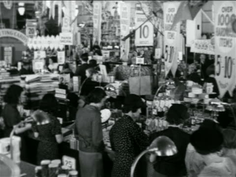 b/w 1938 people shopping in crowded 5 and 10 store / industrial - discount shop stock videos & royalty-free footage