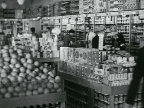 B/W 1938 PAN people shopping in grocery store / industrial