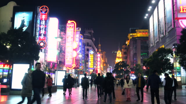 people shopping in shanghai nanjing road - nanjing stock-videos und b-roll-filmmaterial