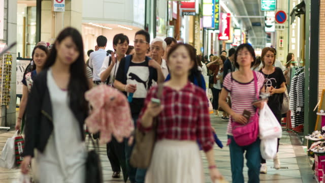 people shopping in shinsaibashi - retail place stock videos & royalty-free footage