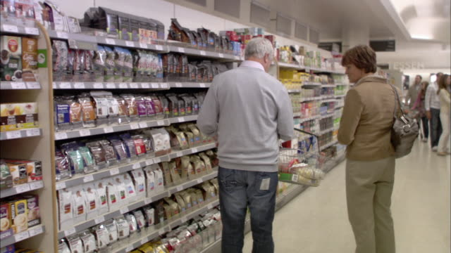 WS POV People shopping in supermarket / North Finchley, London, UK
