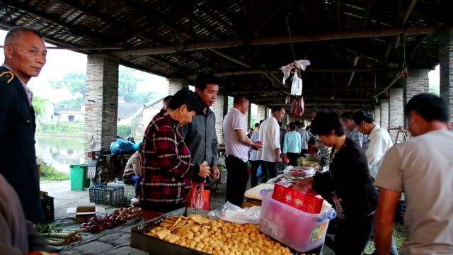 Fuzhou, China - May 29, 2017: People shopping in the local market preparing for the the Dragon Boat Festival in the old town.