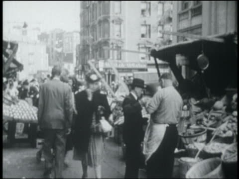 b/w 1949 people shopping + street vendors on crowded city sidewalk / nyc - 1949 stock videos & royalty-free footage