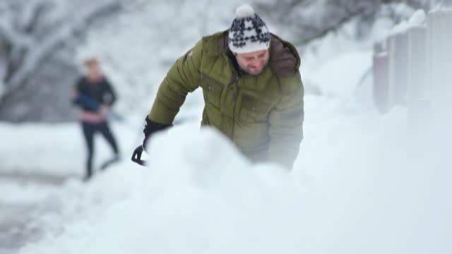 hd: people shoveling snow - digging stock videos and b-roll footage