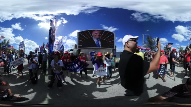 vídeos y material grabado en eventos de stock de people show their support for president donald trump near his maralago resort home on march 4 2017 in west palm beach florida president trump spent... - mp4