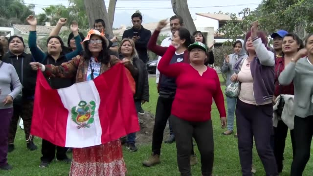 People show their support to Peruvian former president Alberto Fujimori outside his home in Lima after a Peruvian court annulled the humanitarian...