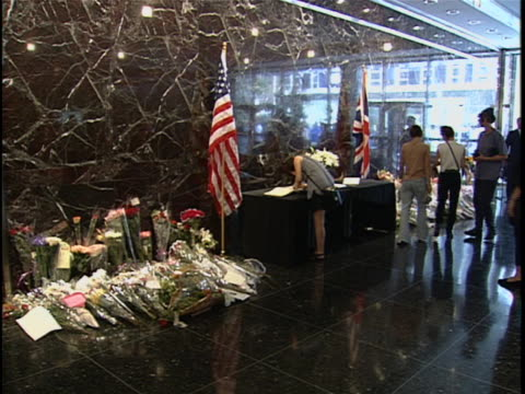 people sign the condolence book for princess diana next to her tribute in the british consulate lobby. princess diana died in a car crash in the pont... - consoling stock videos & royalty-free footage