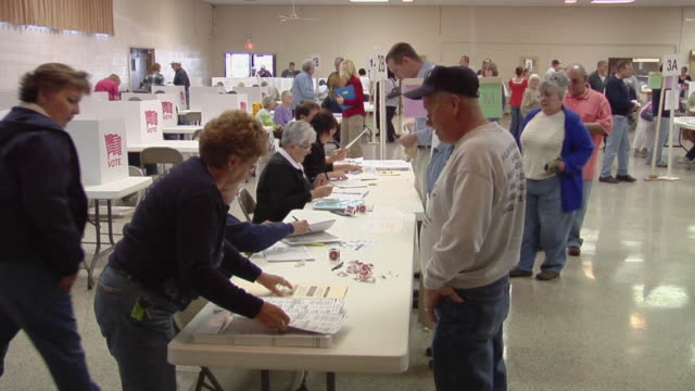 MS, People signing in at registration table at polling place, St. Marys, Ohio, USA