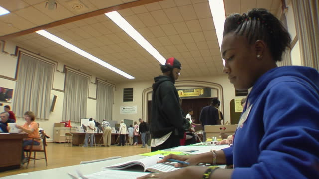 ms, people signing in at registration table at polling place, toledo, ohio, usa - voting stock videos & royalty-free footage