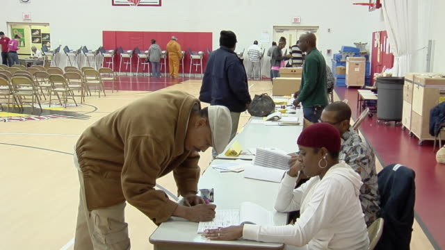ms, people signing in at registration table at polling place, toledo, ohio, usa - registration stock videos & royalty-free footage