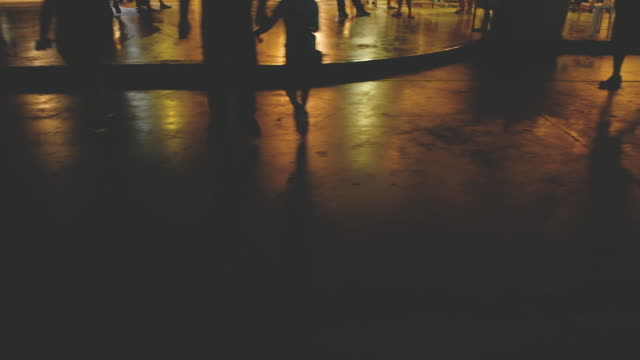 people silhouettes  the lights of night city - asfalto video stock e b–roll
