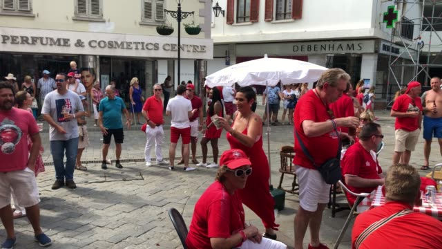 people sing and dance outside a bar on gibraltar national day on september 10 2018 in gibraltar gibraltar first held in 1993 national day is treated... - southern european stock videos & royalty-free footage