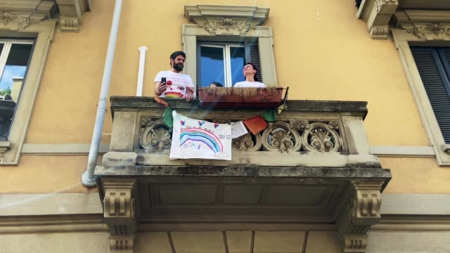 people sing from a balcony to celebrate the italy celebration day on april 25, 2020 in milan, italy. italy continues its lockdown to contain the... - balcony stock videos & royalty-free footage