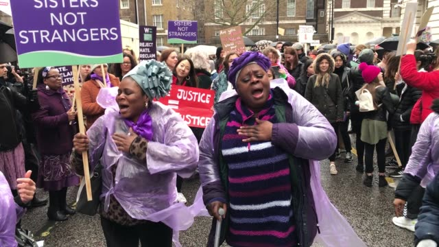 people sing 'we shall overcome' during the march4women in central london on international women's day - 国際女性デー点の映像素材/bロール
