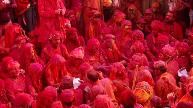 people singing folk songs at holi, festival of colour, while people throwing colors on them - spiritualität stock-videos und b-roll-filmmaterial