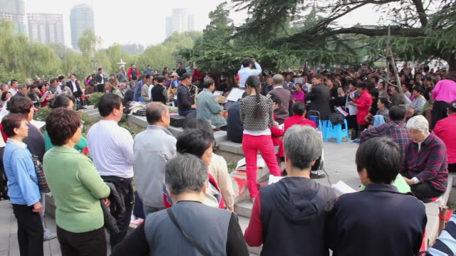 WS PAN People singing traditional songs in park/xian,shaanxi,China