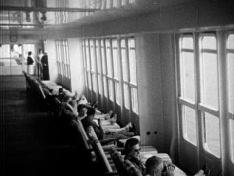 People sit in the observation room of the new ocean liner Canberra