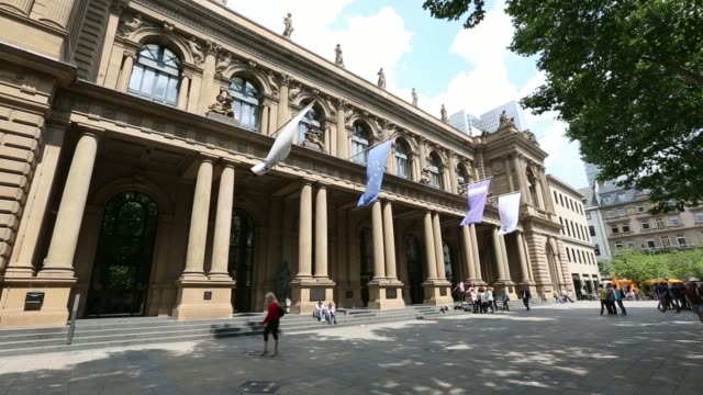 people sit in the sunshine on the steps of the frankfurt stock exchange in frankfurt germany on tuesday june 3 exterior general views of the... - frankfurt stock exchange stock videos and b-roll footage
