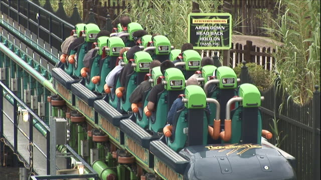 people sit in the train of a roller coaster ride. - roller coaster stock videos & royalty-free footage