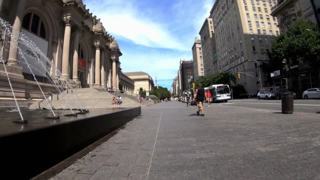 people sit on the steps of the metropolitan museum of art, aka the met, as the city continues phase 4 of re-opening following restrictions imposed to... - metropolitan museum of art new york city stock videos & royalty-free footage