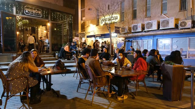 people sit outside a newly reopened restaurant on march 10 in jerusalem, israel. following israel's immunization campaign israeli cabinet eased... - israel stock videos & royalty-free footage