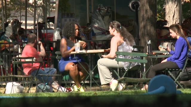 people sit outside for lunch in the park because of the warm october weather unseasonably warm october day in new york city on october 18 2016 in... - b roll stock videos & royalty-free footage