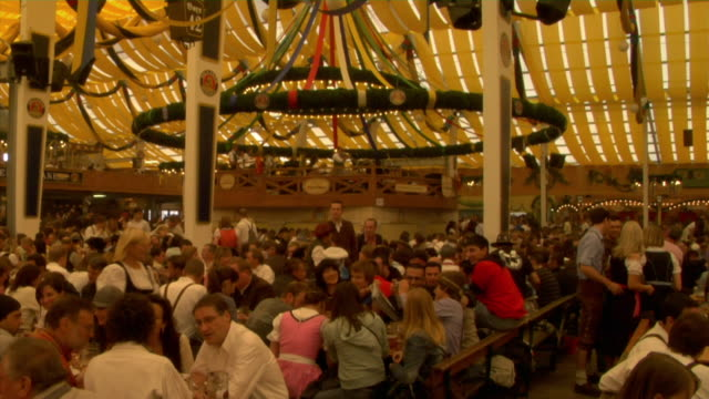 WS TD TU People sitting and drinking beer at beer hall, Oktoberfest, Munich, Germany
