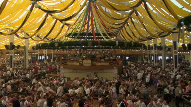ws ha people sitting and drinking beer at beer hall, oktoberfest, munich, germany - oktoberfest stock videos & royalty-free footage