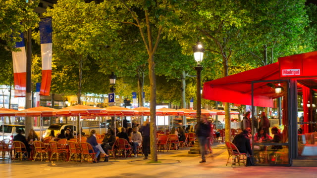 people sitting at a pavement cafe on the champs elysees avenue, paris, france - time lapse - dining stock videos & royalty-free footage